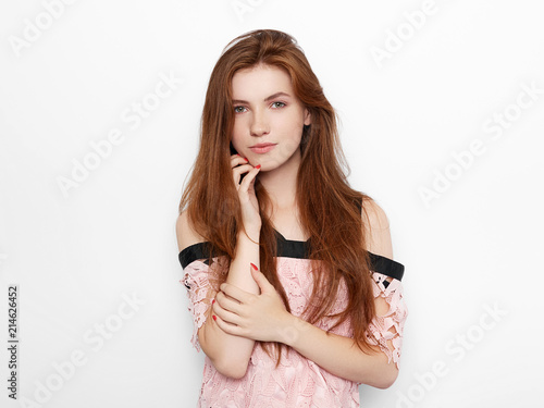 Valokuva  Young beautiful excited woman with gorgeous natural red hair green eyes, blank c