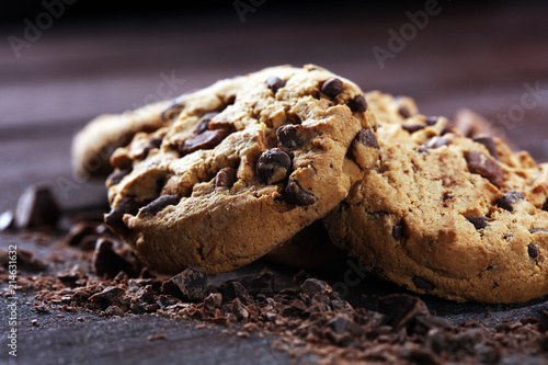 Fotobehang Koekjes Chocolate cookies on table. Chocolate chip cookies shot with chocolate