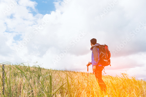 841fd6c3071f Traveler Man climbing with backpack Travel Lifestyle concept active adventure  summer vacations hiking outdoor mountains landscape on background with ...