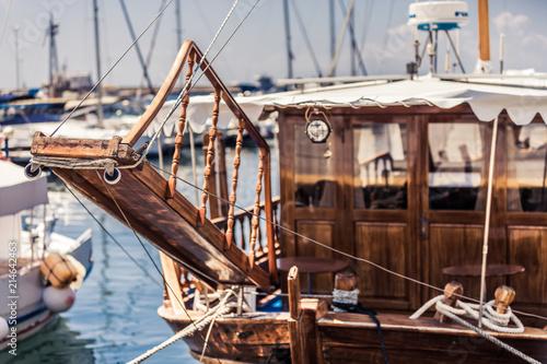 Tuinposter Schip Wooden boat sailboat in harbor