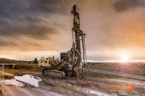 Fotografia  Drilling machine working on a construction site