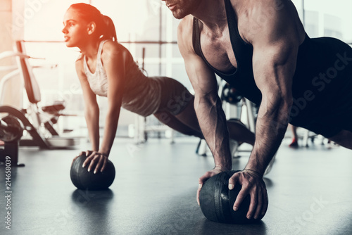 Young Man and Woman Training in Fitness Club.