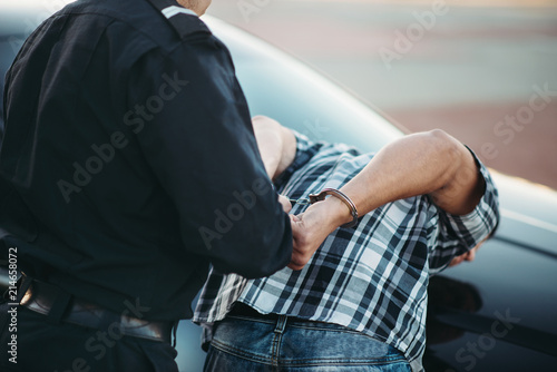 Fotografia Police officer arrests the driver violator on road