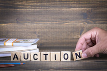 Auction Concept. Wooden Letters On The Office Desk, Informative And Communication Background