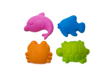 Shaped Sandstone And Kinetic Sand Toys. Children's Entertainment. Sand Molds On White Background