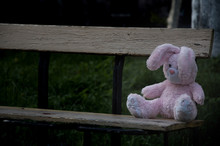 Lonely Forgotten Abandoned Teddy Toy Bunny Rabbit Sat On An Old Wooden Bench And Waiting For Owner. Concept: Depression.