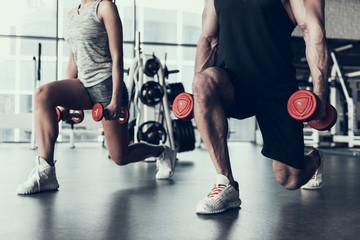 Fototapeta na wymiar Close up. Man and Woman Training in Fitness Club.