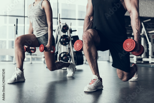 Close up. Man and Woman Training in Fitness Club.