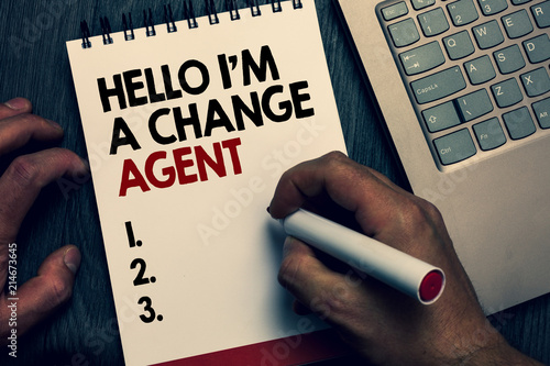Text sign showing Hello I am A Change Agent. Conceptual photo Promoting and enabling difference evolution new Written words and number on notepad man hold marker keyboard on wooden desk.