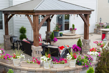 Colorful Summer Flowers On A Curved Exterior Patio