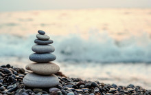Made Of Stone Tower On The Beach And Blur Background