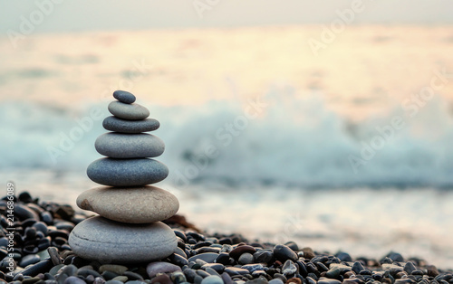 made of stone tower on the beach and blur background Canvas Print