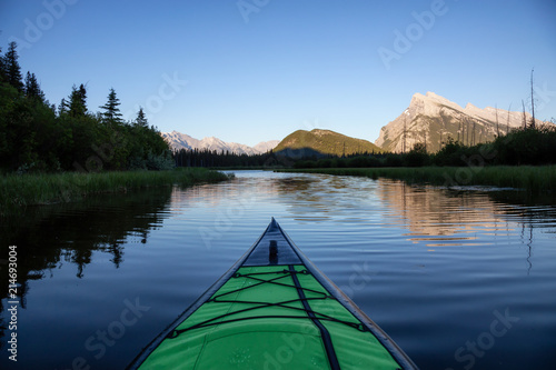Photo Stands Lake Kayaking in a beautiful lake surrounded by the Canadian Mountain Landscape. Taken in Vermilion Lakes, Banff, Alberta, Canada.