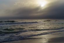 Sun Peeking Through Storm Clou...