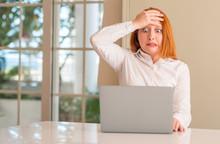 Redhead Woman Using Computer L...