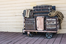 Vintage Luggage On Cart At Old Railroad Station