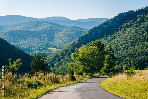 A road and view of mountains in the rural Potomac Highlands of West Virginia Wallpaper Mural