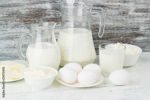 Tuinposter Zuivelproducten Different dairy products on the wooden background