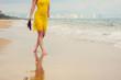 A girl is walking on a beach