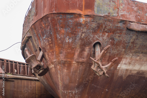 Close up two old rusty anchors on broken abandoned rusty ship
