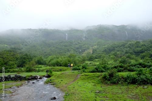 Fotobehang Wit Beautiful landscape waterfall on western ghat mountain and hills in rainy season
