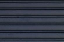 Roller Shutter Doors - Grey Background - Close Up