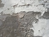 Texture of a stone wall. Old wall background. Stone wall as a background or texture. Corrosion on a stone wall.