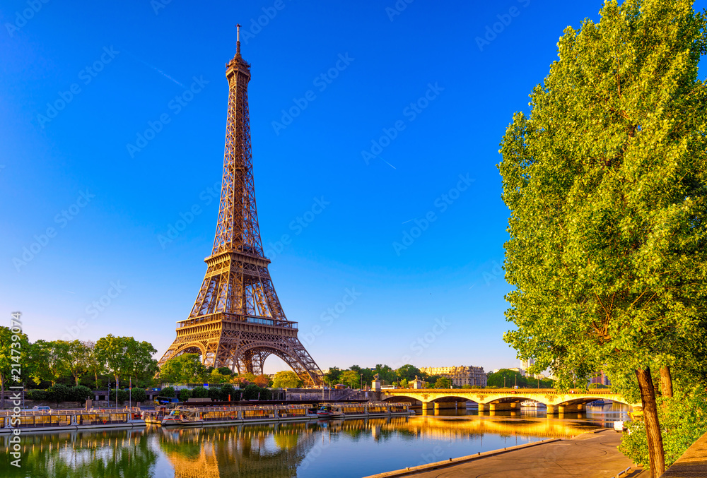 Fototapety, obrazy: View of Eiffel Tower and river Seine at sunrise in Paris, France. Eiffel Tower is one of the most iconic landmarks of Paris