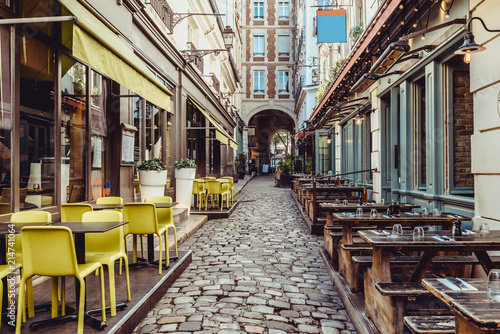 Papel de parede Cozy street near Boulevard San-German with tables of cafe and pub  in Paris, Fra