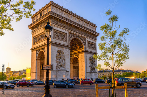 Paris Arc de Triomphe (Triumphal Arch), place Charles de Gaulle in Chaps Elysees at sunset, Paris, France.