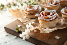 Tasty Apple Roses From Puff Pastry On Wooden Board