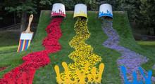 Background. Installation. Three Cans Of Paint \ Red, Blue, Yellow \ And Giant Tassel. Flowers In The Form Of Spilled Paint.