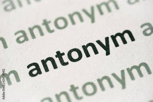 Photo word antonym printed on paper macro