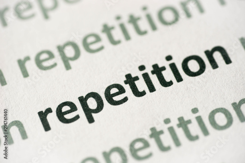 Photo  word repetition printed on paper macro