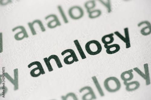 Photo word analogy printed on paper macro