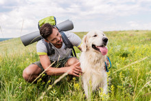 Traveler With Backpack And Dog...