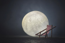 Beach Lounger In The Background Of The Moon