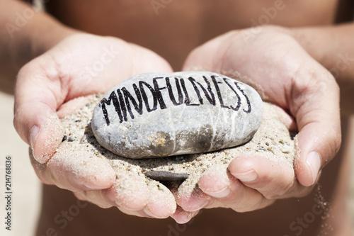 Carta da parati man on the beach and text mindfulness