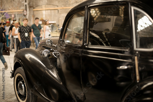 Aluminium Prints Old cars Fragmeyn of a retro black car with close top at an exhibition 'Pin up' in the old premises of an abandoned factory in Kharkov, Ukraine, 05.19..2018
