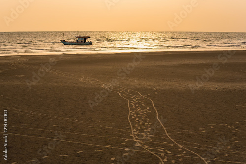 Floating fishing boats aground at the harbor in the sea sunset time at Chanthaburi, Thailand Wallpaper Mural