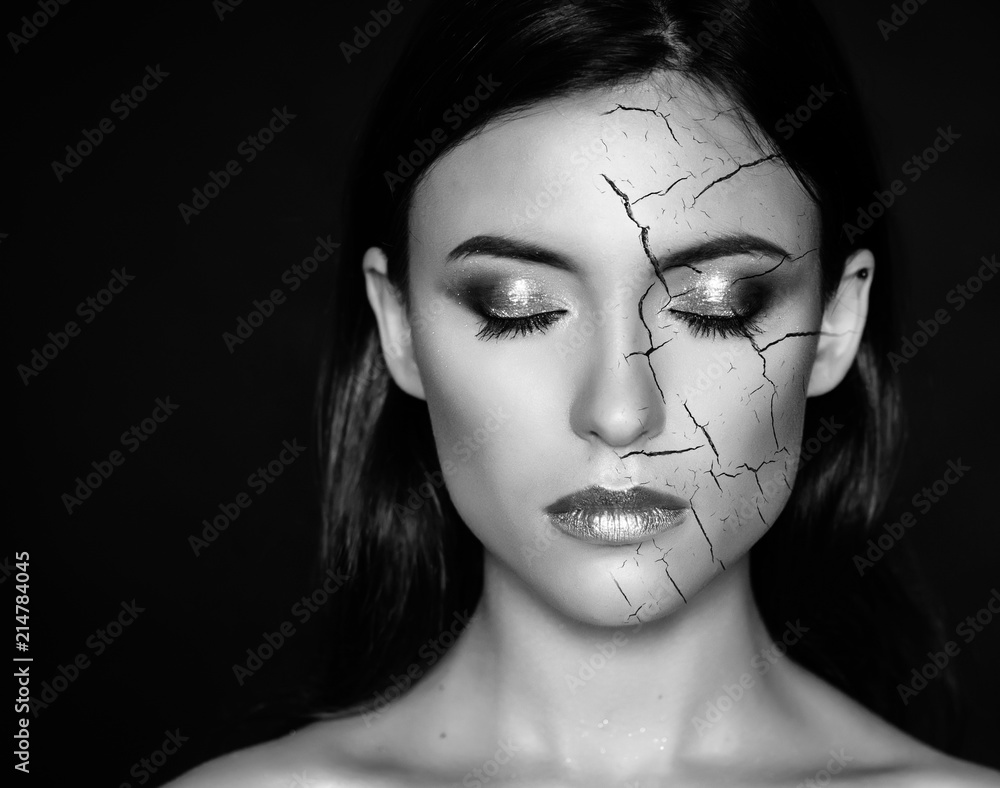 Fototapeta Woman with cracked face as cosmetic and dehydration effect concept.
