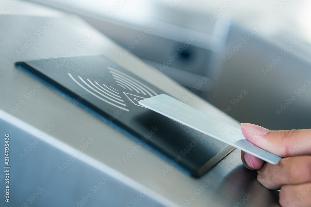 Fototapeta Hand holding Blue Card to access Electronic Entrance Scanner