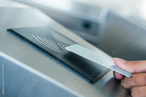 Fotografiet Hand holding Blue Card to access Electronic Entrance Scanner