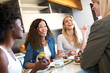 canvas print picture - Group of friends laughing while eating healthy food at home.