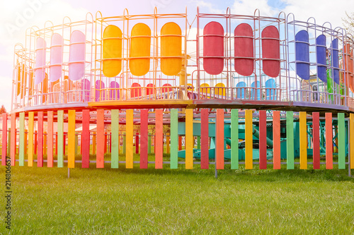 Foto  Bright centrifugal carousel in a recreation park