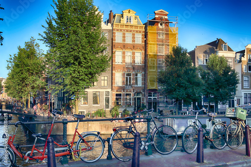 AMSTERDAM, NETHERLANDS - JULY 08, 2018 : Canal with boats in Summer Canvas Print