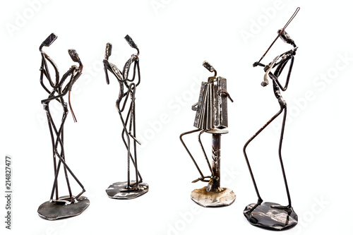 Creative figures of musicians, violinist and accordionist are playing for couple who dancing tango with passion