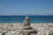 Stone tower on a beach covered with pebble