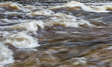 Abstract Shot Of Water Rapids With Foaming And Violent Water