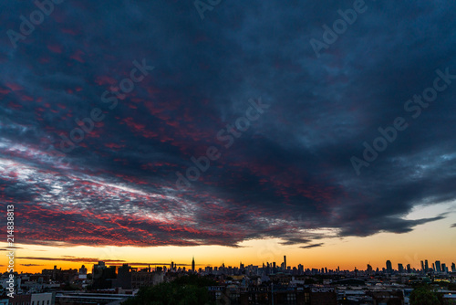 Sunset after a storm over New York Skyline